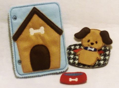 """Dog house finger puppet quiet book page includes dog house page with puppy dog, food bowl, and doggie bed Quiet book page measures 5"""" x 7"""" with a pocket on the back to carry the pieces and can be adde"""