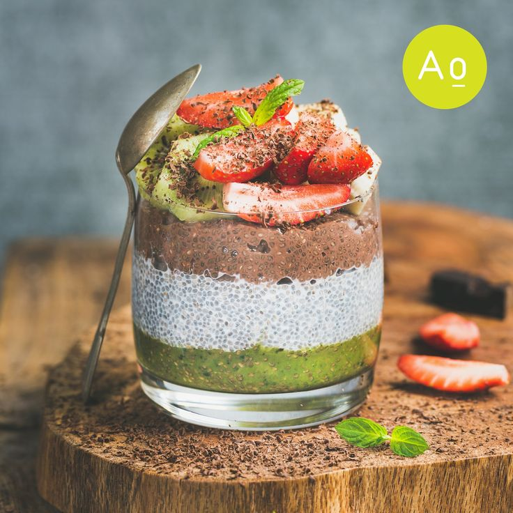 Healthy breakfast. Matcha, almond milk, cocoa chia seed pudding with fresh fruit, berries, mint & chocolate.