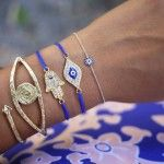 I need to go to Micheal's to revive my evil eye and fatima hand bracelets! Love the blue cord!!