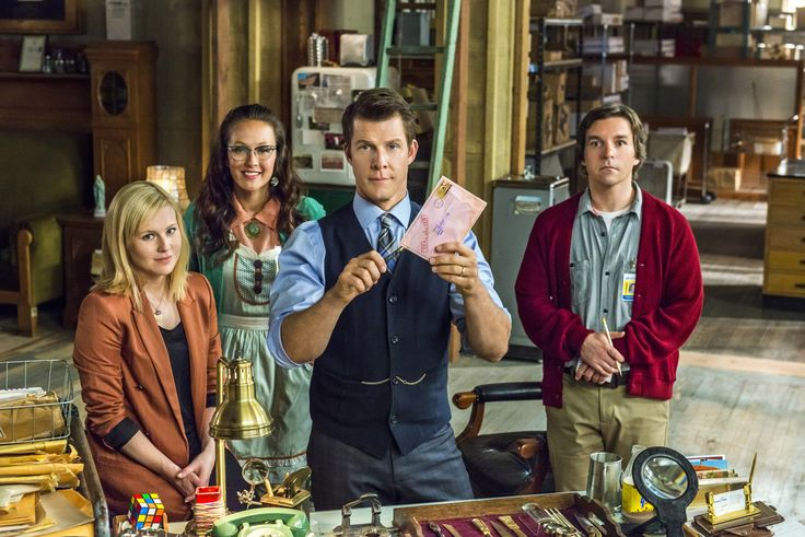 A scene from Signed, Sealed, Delivered From left to right: Kristin Booth as Shane Crystal Lowe as Rita Eric Mabius as Oliver Geoff Gustafson as Norman © Crown Media United States, LLC