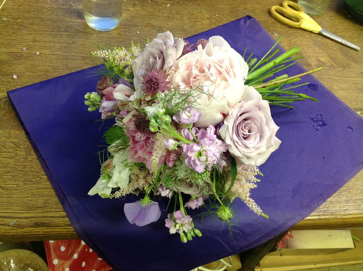 """Eclectic bouquet of Safi roses, stocks, sweet peas, nigella """"love in a mist"""", astilbe, peonies."""