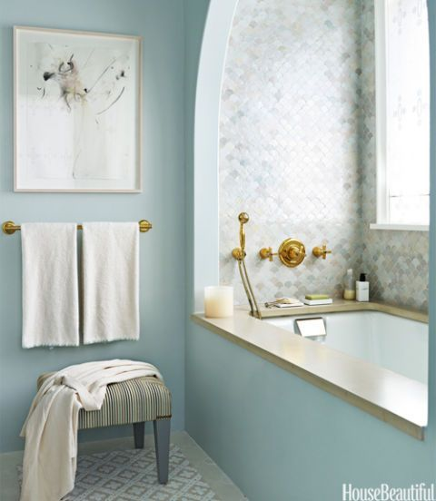 Creating an idyllic bath for a Long Island home, designer DD Allen choose a blue palette but did not limit herself to one shade. The custom watery blue of the polished Venetian plaster walls picks up the blue in the floor tiles. Waterworks Classic Undermount tub. Venetian Plaster by JJ Snyder Studio. Architecture by Michael Pierce.   - HouseBeautiful.com