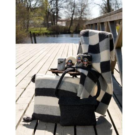 Tovad filt, kudde, väska och mobilväska