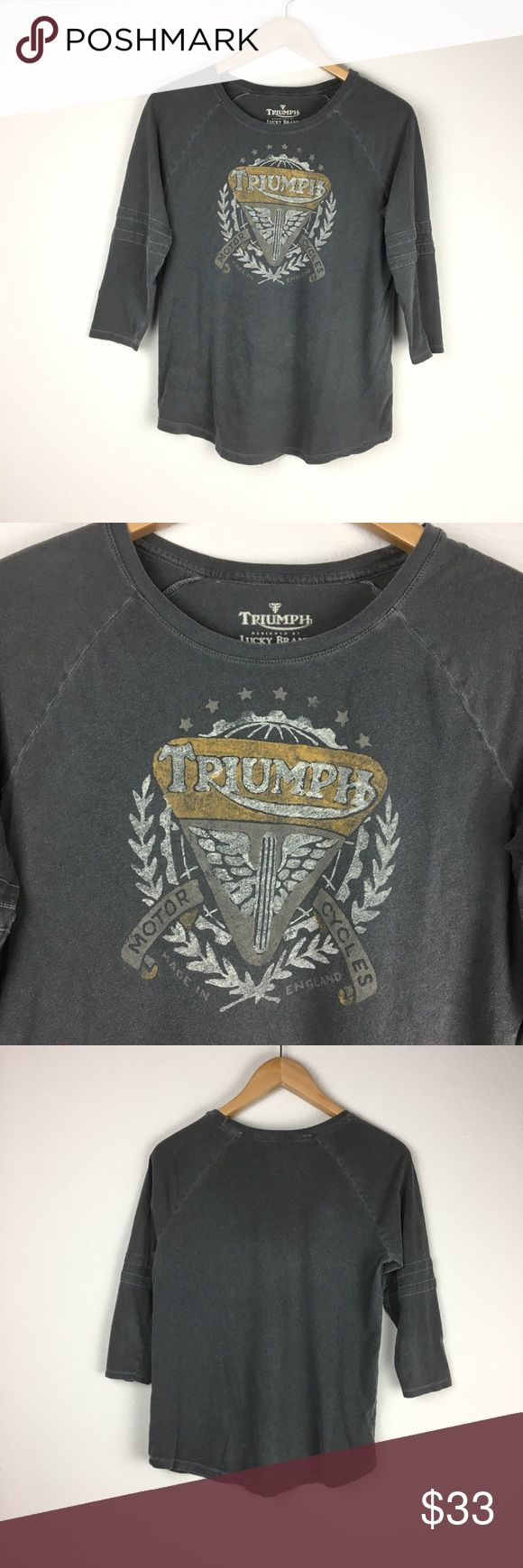"""Triumph Motorcycle Lucky Brand Tee Shirt 100% cotton.  Triumph designed by Lucky Brand.  Triumph motorcycles.  Intentional """"worn-in"""" look and feel. Dark gray with graphic printed on front.  ¾ length sleeves with subtle stripes.  Round neckline.  Excellent pre-owned condition. Lucky Brand Tops Tees - Long Sleeve"""