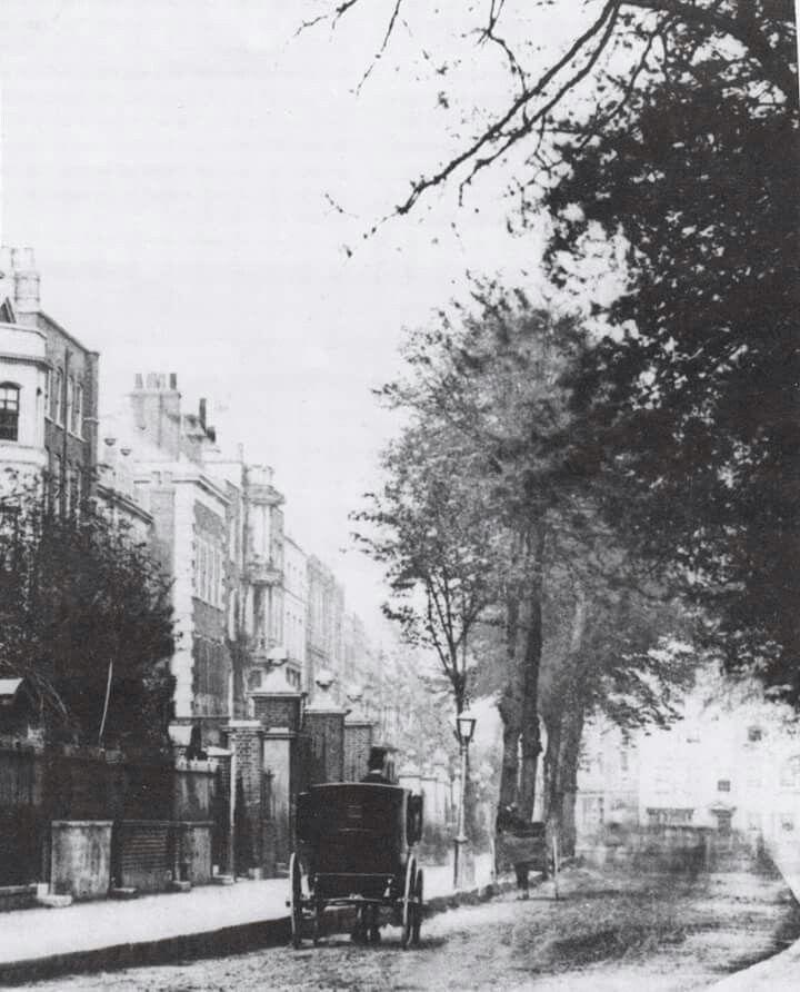 ...CHEYNE WALK....A carriage with top-hatted coachman waits outside one of Cheyne Walk's many grand Georgian houses....