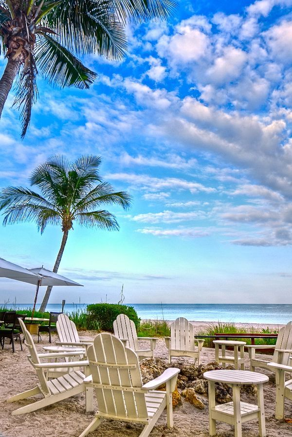 Wow it's Adirondack heaven with blue skies, cloud love and the sea thrown in for good measure!  Naples Beach, Florida