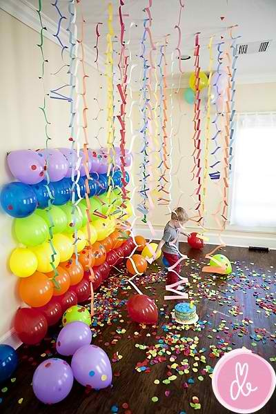 Re-create this look using http://fancyfunctions.co.uk/Crepe-Rolls-Streamers-10-Metre-x-2-Halloween-Christmas-Party-Decorations-6pk and stick your choice of balloons on the wall http://fancyfunctions.co.uk/index.php?route=product/search&search=latex%20balloons