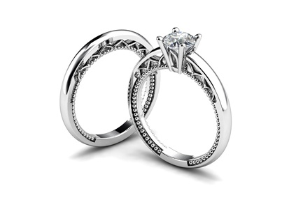 Embellished prong set diamond engagement and wedding ring set in white gold, by T & T Jewellers.