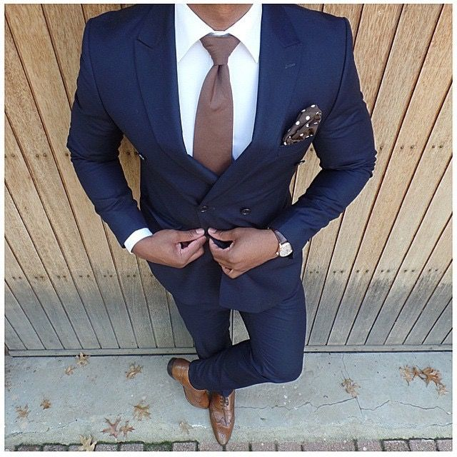 Navy and brown. Nice color combo actually. This is a great business professional look for men.