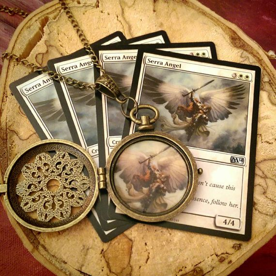 Check out this item in my Etsy shop https://www.etsy.com/ca/listing/286651093/magic-the-gathering-serra-angel-locket