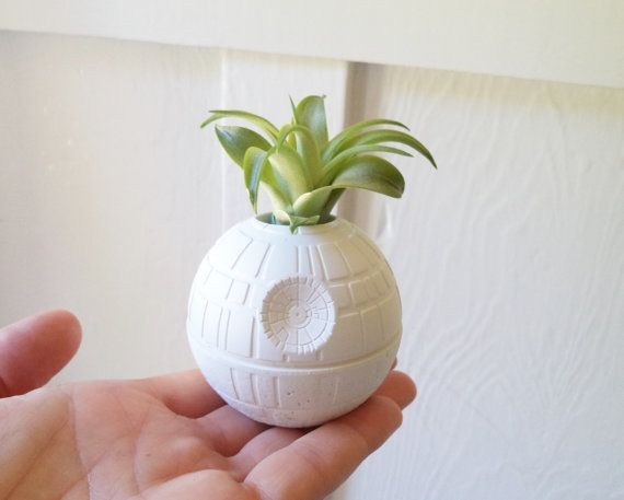The perfect little geek chic gift!...  The Death Star measures 2.5 (listing is for 1 Death Star)  Hole for plant will measure 7/8 - designed for air plants.  Will come with an air plant, or without.... your choice! ( you can also order it as a decorative sculpture...no plant, no hole)   **see my shop for the Millennium Falcon!**here: https://www.etsy.com/listing/289132889/millennium-falcon-planter-air-plant?ref=related-0  Also super fun as a simple desk or book shelf decoration... any nerdy…