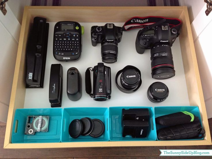 I like how she has a pull-out drawer for her camera equipment and bigger office supplies like this (The Sunny Side Up blog home office tour)