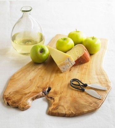 Hand-carved from the root of a reclaimed Chinese fir, our unique board comes with two mouse-faced cheese knives. Slice apples, cheese or snacks and serve right on the board.
