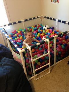 Home made ball pit for kids. Use PVC from Home Depot and balls from toys r us