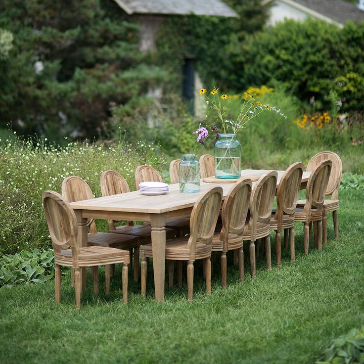 Designed and hand-crafted exclusively for terrain, this reclaimed teak dining chair brings elegant, indoor design to the patio with a graceful oval ba