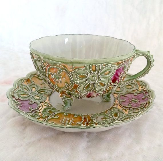 Antique Unmarked Nippon Hand Painted Moriage Tea Cup & Saucer. Florals And Rosettes On Gilt Background. 3 Footed Porcelain Tea Cup.