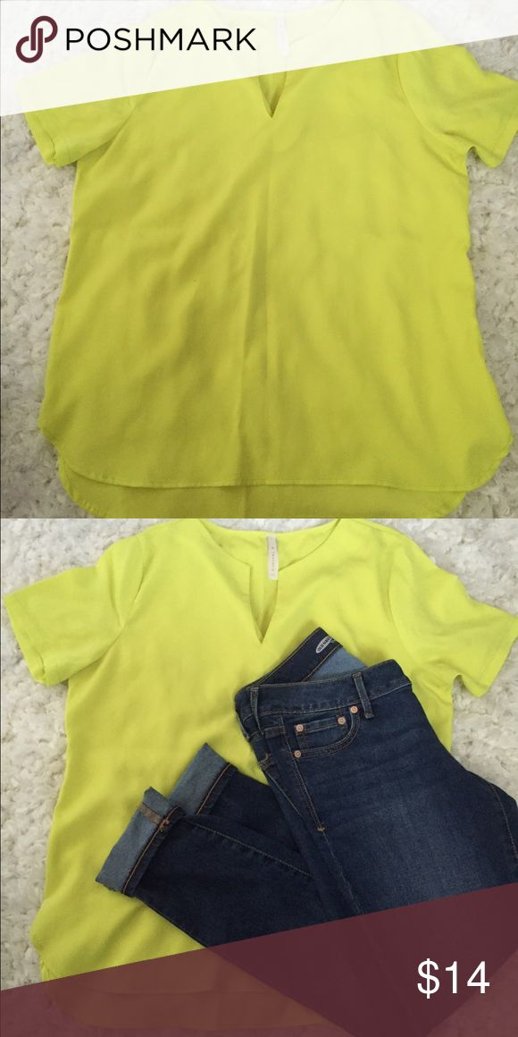 Neon Yellow Top This Yellow top is great for layering or just a casual look with jeans. In great condition only worn a few times. Accepting reasonable offers. Tops Tees - Short Sleeve