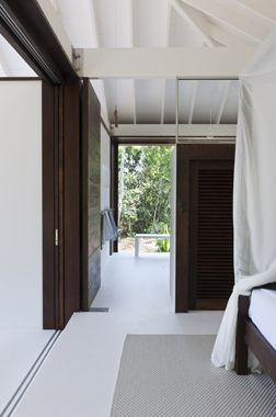 tropical beach house  queensland  completed  2011  a small one bedroom beach house. the primary design elements are shutters made out of low-maintenance native hardwoods that will age and eventually blend in with the surrounding tropical landscape.