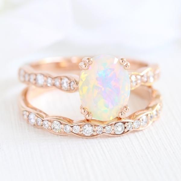 Elegant opal bridal set features a rose gold opal engagement ring set in solitai…