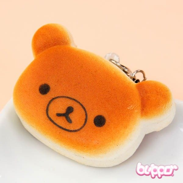 This adorable Rilakkuma charm looks just like a yummy and sweet Rilakkuma shaped pancake! The charm includes an elastic strap, so you can attach it to hang on your phone, bag or anywhere you like. So soft and cute, just like pancakes in the morning!
