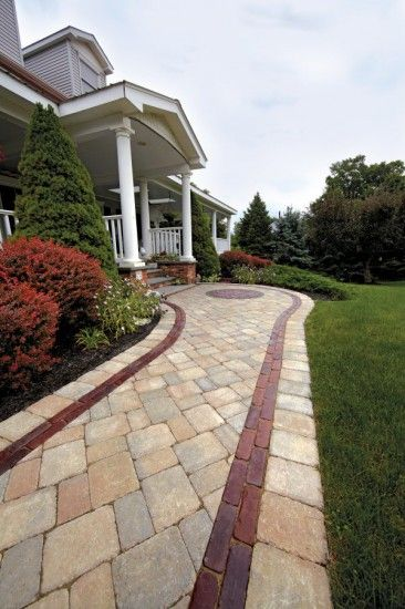 Unilock Walkway Entrance featuring Brussels Block paver with Copthorne accent