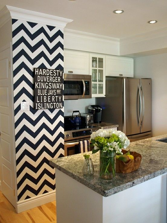 Chevrons in navy blue on a yellow wall with gray accents in the bathroom! That would be cute!