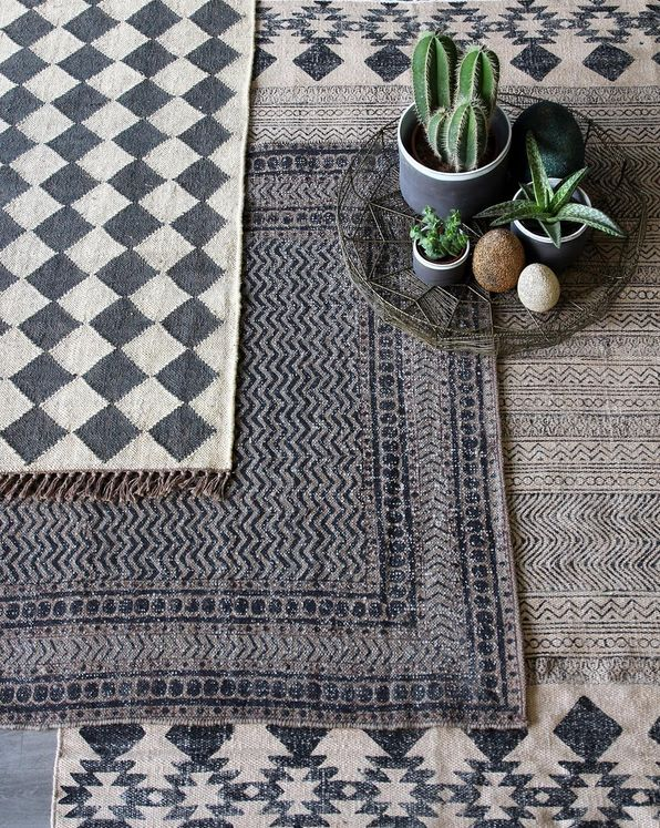 Layering rugs, texture and scale