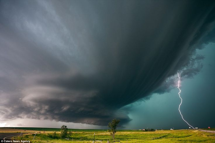 This thunderstorm in Chamberlain, South Dakota, is among a number of scenes captured by Mr Hollingshead since he started chasing storms in 1...