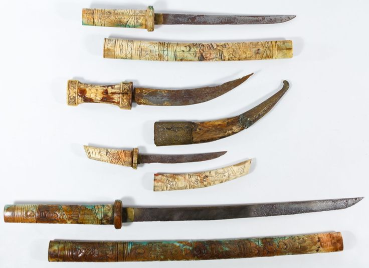 Lot 294: Asian Carved Bone Sword Assortment; Four items including three knives with Asian figural carved bone handles and scabbards and a near Eastern curved knife with bone handle and metal and wood scabbard