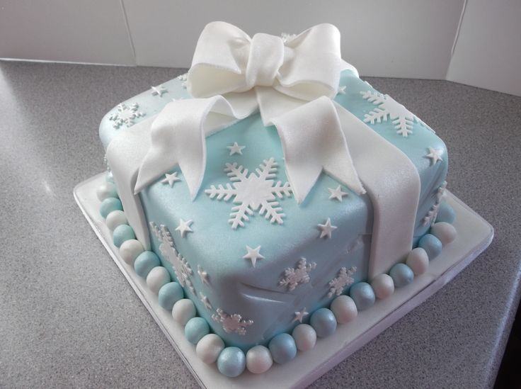Christmas present - Rich fruit cake, marzipan and fondant with gum paste snowflakes and stars