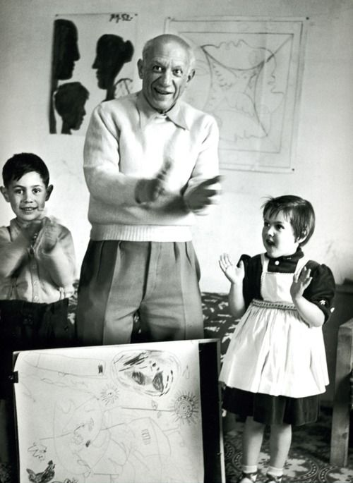 """Picasso and his children celebrating the completion of a collaborative drawing, 1953."""