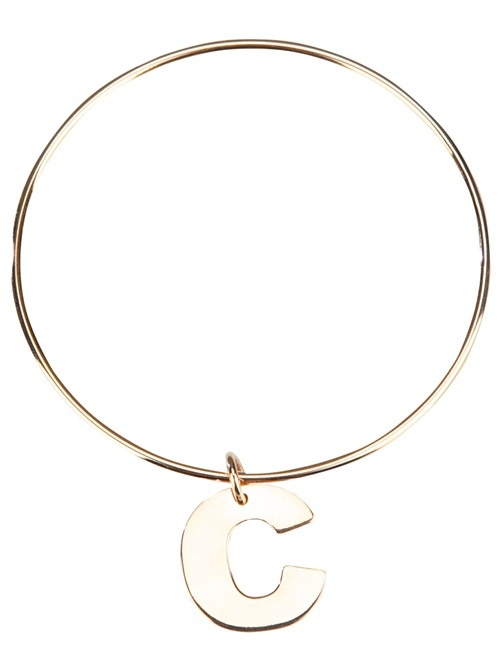 Silver bangle bracelet from Maman et Sophie featuring a large contrasting 'C' letter charm piece.