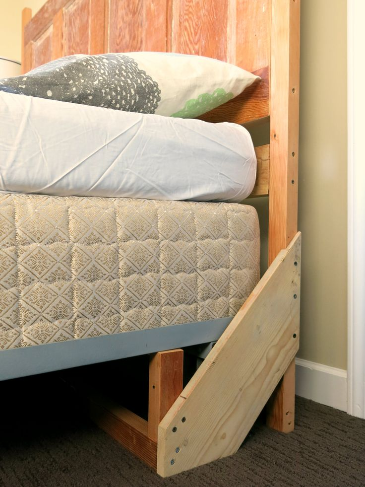 How to build a sturdy freestanding bed frame headboard. Solves problem of an upright wooden door headboard, fixed by dropping the metal frame onto the headboard structure. Cross member at base of headboard and forward end of bracket.