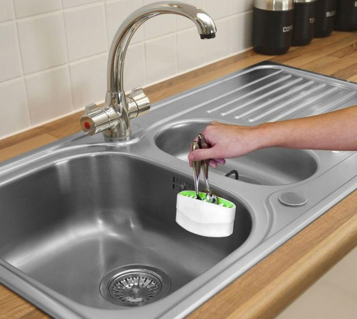 The Cutlery Cleaner Attaches To Your Sink