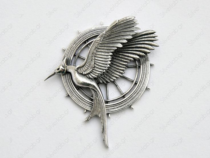 https://www.etsy.com/listing/151164873/hunger-games-mockingjay-pendant-katniss This replica pendant is handcrafted and also available as a pin on request.