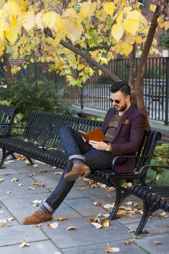 Wear a dark purple blazer with navy skinny jeans if you're going for a neat, stylish look. Tap into some David Gandy dapperness and complete your look with brown suede loafers.  Shop this look for $491:  http://lookastic.com/men/looks/loafers-socks-skinny-jeans-pocket-square-crew-neck-sweater-blazer/4213  — Brown Suede Loafers  — Grey Socks  — Navy Skinny Jeans  — Brown Pocket Square  — Brown Fair Isle Crew-neck Sweater  — Dark Purple Blazer