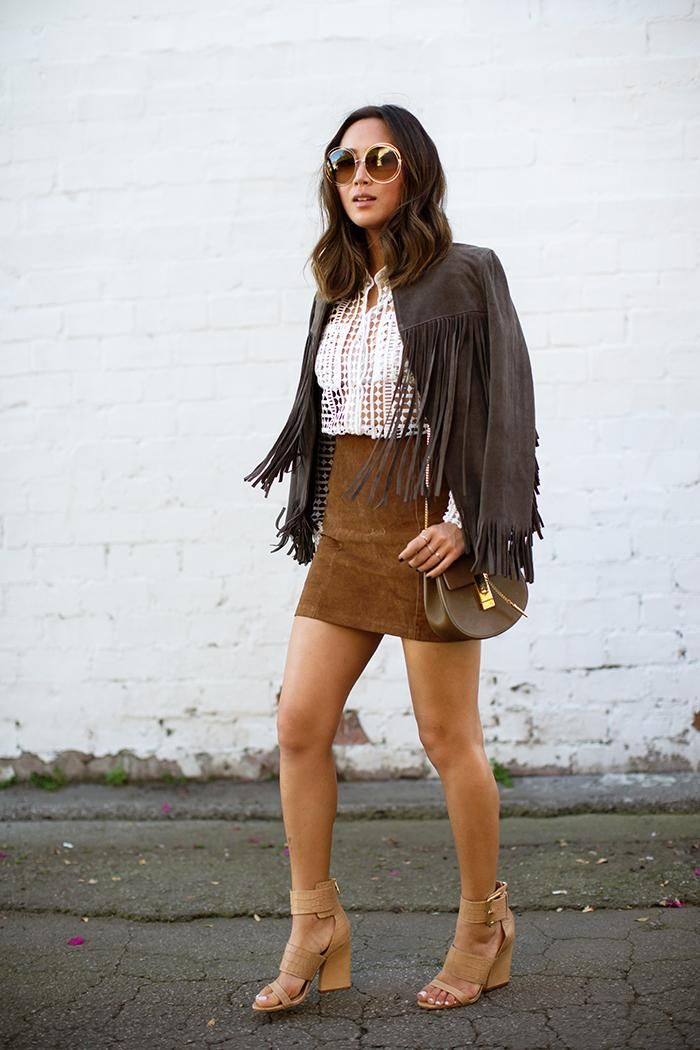 45 Street Style Inspired Ways to Wear a Mini Skirt Through Fall - Blogger Aimie Song wearing a brown suede mini skirt, fringe jacket, Chloé 'Drew' saddle bag, and nude heeled sandals