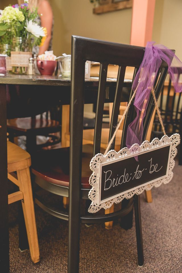 purple themed bridal shower%0A Bride to be sign on chalkboard with white dollie frame and tied on with  purple tulle