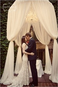 Weddings | Event Spaces - Stunningly elegant draped fabric chuppah with tucked legs & chandelier - #weddings #eventspaces #chuppahs