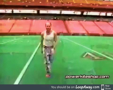 Man throws a flying disc from the field to outside the stadium