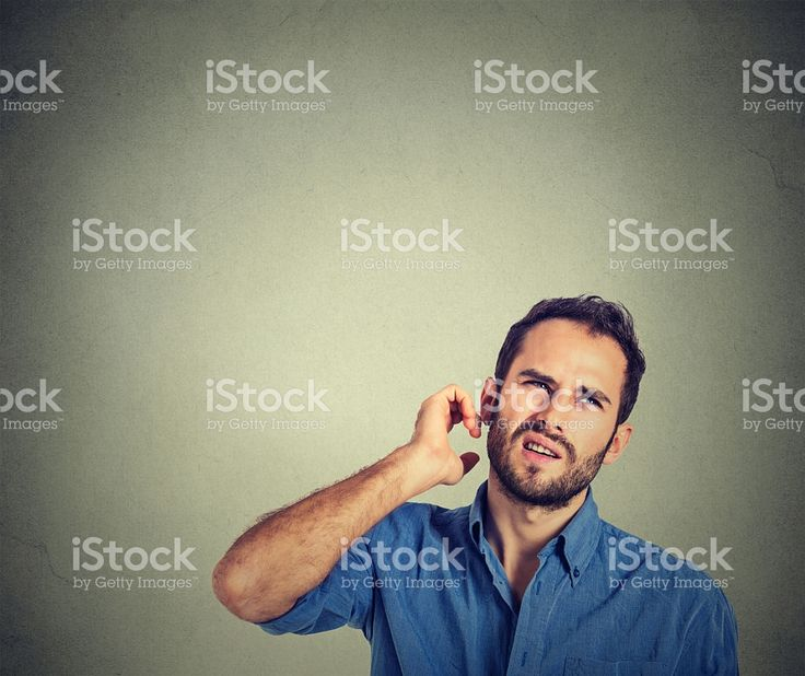 man scratching head, thinking about something, looking up royalty-free stock photo