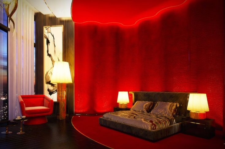 A more extravagant version of the previous red bedroom, with over-the-top decor and a combo of table and floor lamps