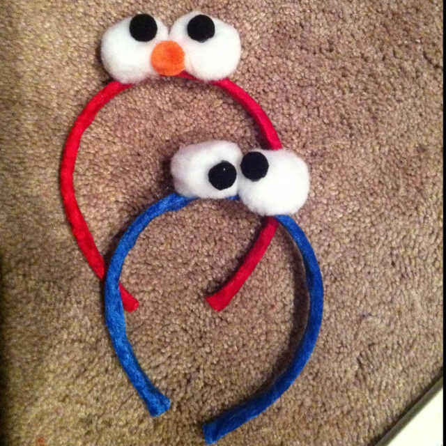 Elmo and Cookie Monster head bands needs: plastic headband, ribbon, jumbo white pom poms, small black and orange pom poms, hot glue gun