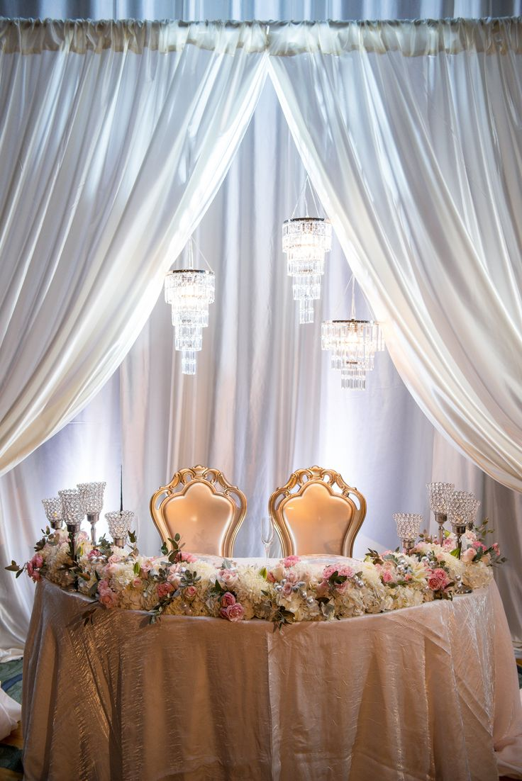 Gorgeous Sweetheart Table With Pipe And Drape And Hanging