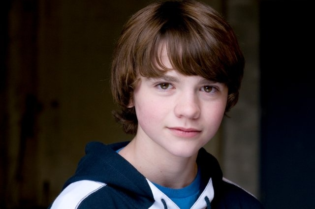 Joel Courtney as Jack Slater. The resemblance appeared to me after watching Super 8, in which he played the role of a shy and sad kid with lots of latent courage and potential.