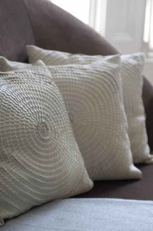 "These off-white pillows are from our feature ""City Glam"""