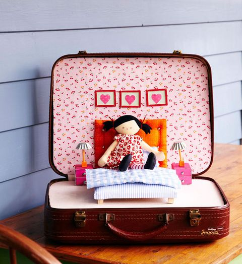 Playtime In An Old Suitcase
