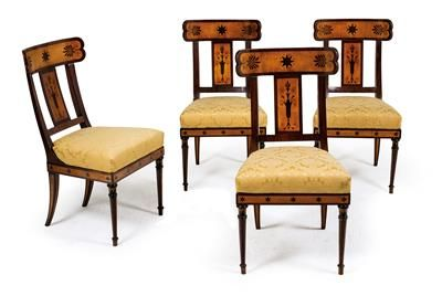 Set of 4 early Biedermeier chairs, in the style of Leo von Klenze (1784–1864), ca. 1810/20. Hardwood chairs veneered in mahogany and maple, with concave backs, star and palmette marquetry on the backrests, uprights and frieze, later upholstery. Wien, Dorotheum, 22.04.15, no. 554.