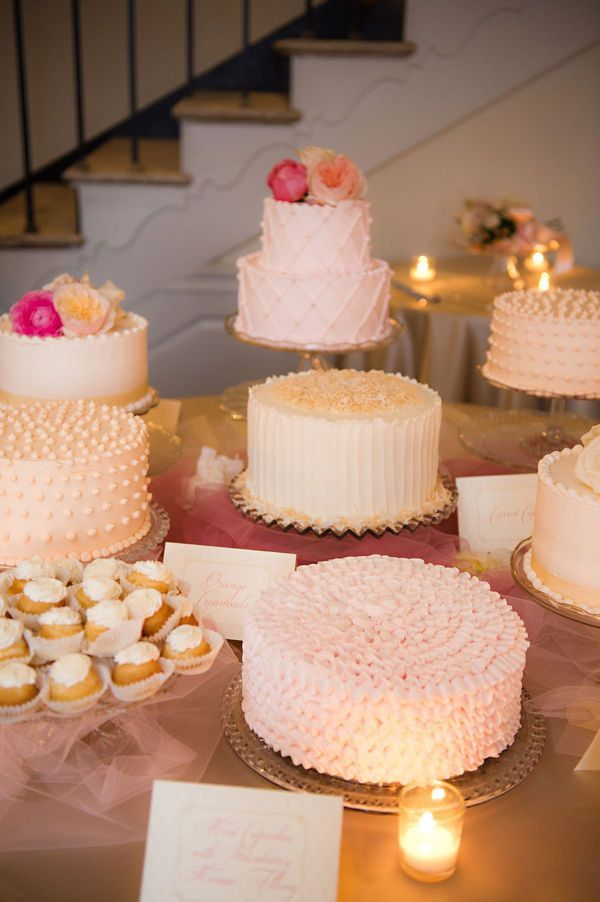 Instead of a traditional wedding cake, have smaller cakes in a pretty display on a table. Love the varying textures and designs on all the different cakes!
