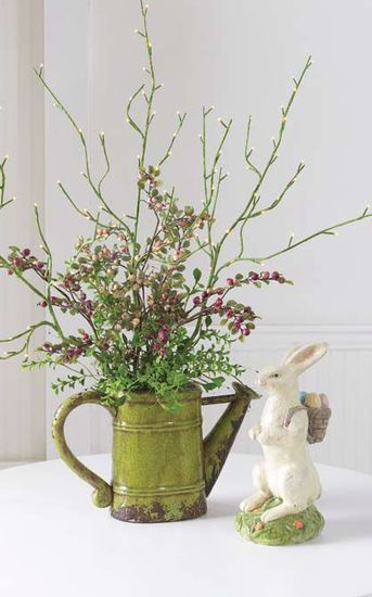 Use copper watering can on little table outside front window with different arrangements for the seasons...bluebonnets, poinsettias, spring mix, easter lillies, fall foliage...